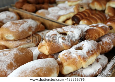 Cakes on a counter of outdoor market - stock photo