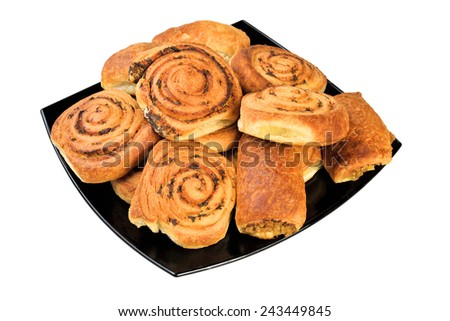 Cakes on a plate. Isolated on white background. - stock photo