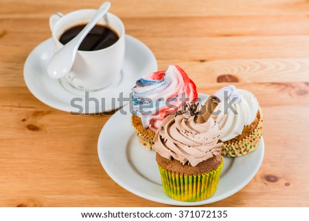 cakes on a saucer with a coffee on a wooden background (shallow DOF) - stock photo