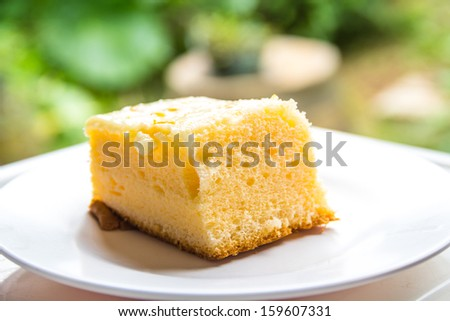 Cakes on a white dish is eaten.