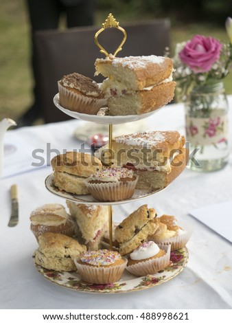 Cakes on stand at table