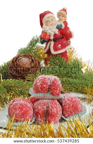Cakes with chocolate cream and Christmas sugar