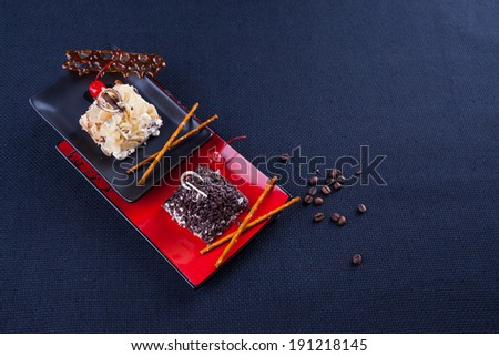 Cakes with cream and nuts, coffee - stock photo