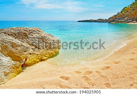 cala biriola rocks on a clear day - stock photo