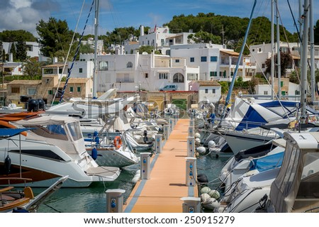 Cala D'Or yacht marina pier with recreational boats. Mallorca, Spain