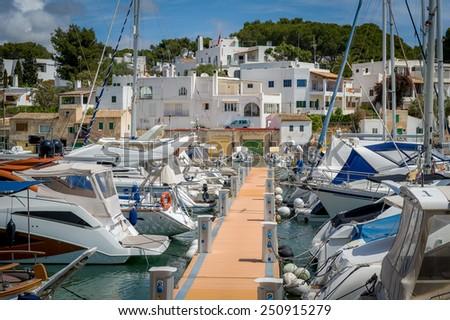 Cala D'Or yacht marina pier with recreational boats. Mallorca, Spain - stock photo