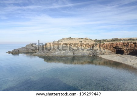 Cala Levante below the lighthouse of Cabo de Palos, Cartagena, Spain - stock photo
