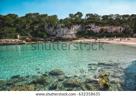 Cala Llombards beach with clear blue water in spring season