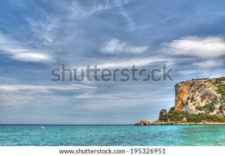 Cala Luna coastline on a cloudy day - stock photo
