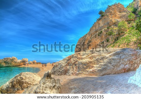 Cala Mariolu shore on a clear day. hdr tone mapping. - stock photo