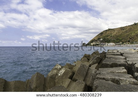 Calabrian coast, Italy, panorama with breakwater and sea