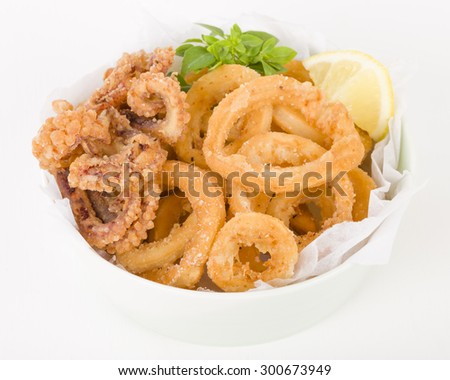Calamari - Deep-fried squid rings served with lemon on a white background. - stock photo