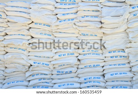 calcium hydroxide or lime in white bags - stock photo