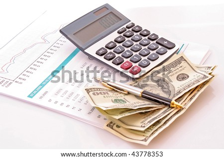 Calculate money with the calculator - stock photo