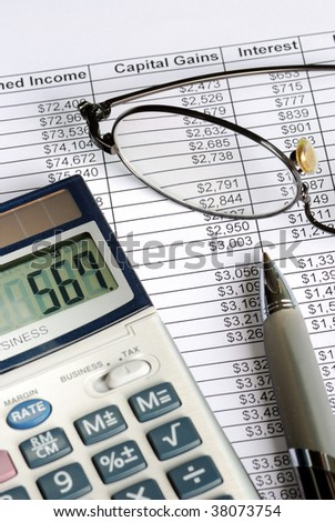 Calculate the capital gain with the calculator - stock photo