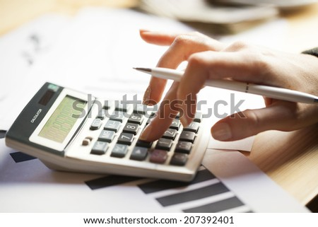 Calculating financial results - stock photo