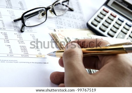 Calculating financials. Creating financial report. - stock photo