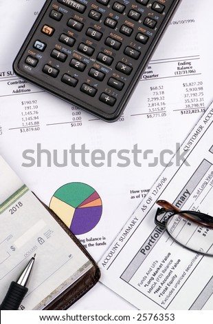 Calculating for the future... checking how much you have in the retirement funds. - stock photo