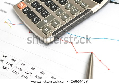 Calculating in the Office on the Desk