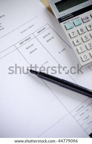 calculating invoice - stock photo