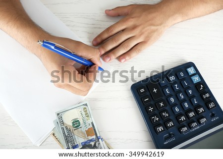 Calculating money, close up
