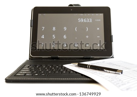 Calculating on digital tablet computer - stock photo