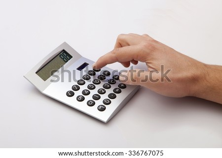 Calculating on the white Desk in the Office - stock photo