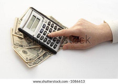 calculating over a fan of money - stock photo