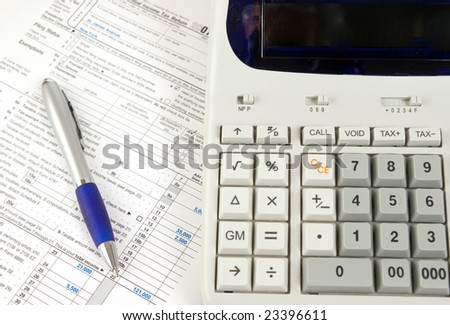 calculating tax - stock photo