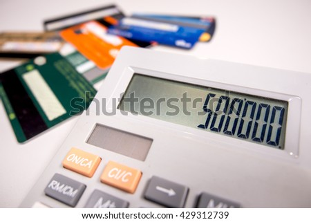 calculating the credit card. - stock photo