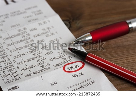 calculation with red pen - stock photo