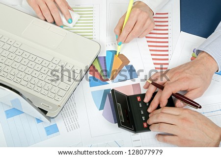 calculations at the office - stock photo