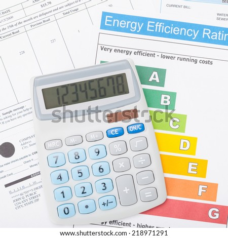 Calculato above utility bill and energy efficiency chart - 1 to 1 ratio - stock photo