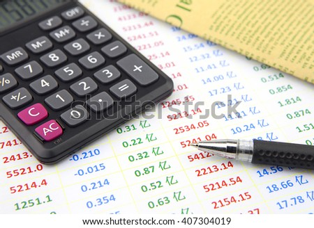 Calculator, accounts, ball pen - stock photo