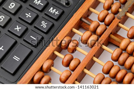 Calculator and abacus - stock photo