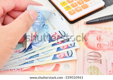 calculator and banknote singapore dollar