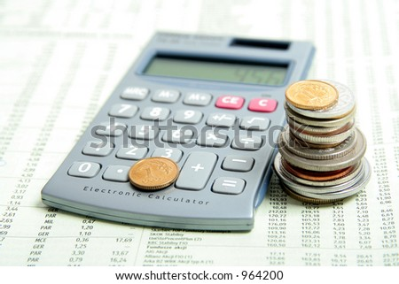 Calculator and Coins On Financial Paper