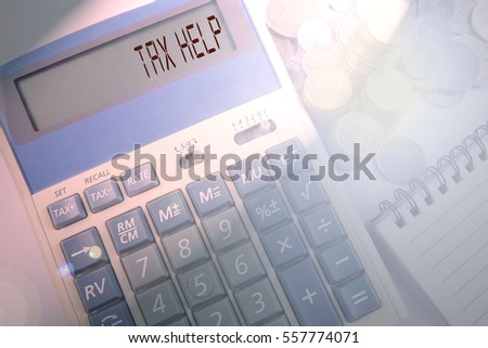 Calculator and coins on white background with business and finance conceptual words. Low light and blurred image, lens flares added.