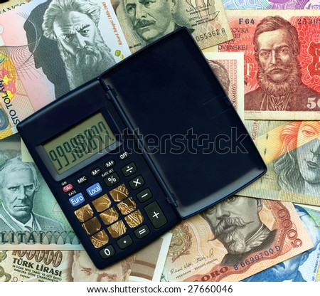 Calculator and coins with paper banknotes from around the world. - stock photo