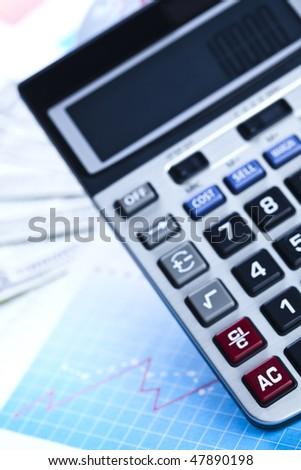 Calculator and diagram - stock photo