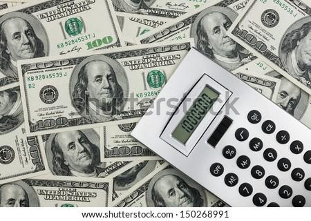 Calculator and dollars  closeup. Business concept  - stock photo