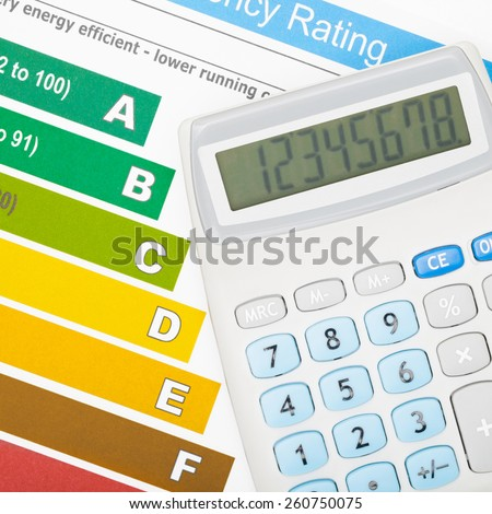 Calculator and energy efficiency chart - stock photo