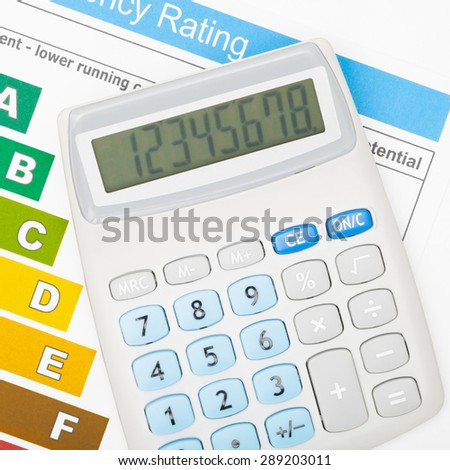 Calculator and energy efficiency chart - close up - stock photo