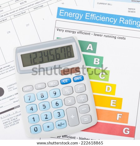 Calculator and energy efficiency chart - 1 to 1 ratio - stock photo