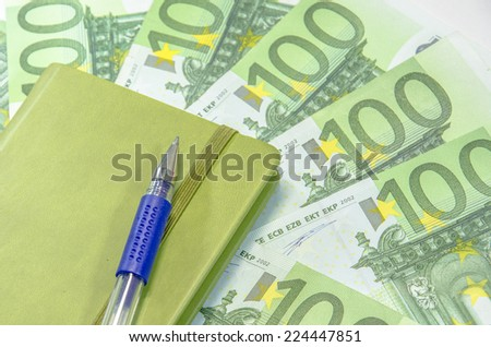 calculator and euro banknotes and notebook with pen - stock photo