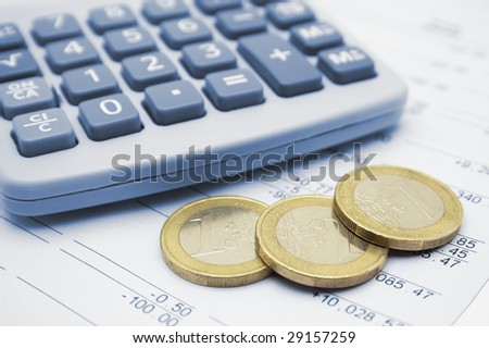 Calculator and euro coins.