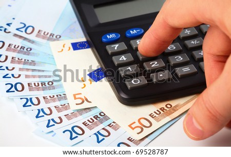Calculator and few Euros - accounting concept - stock photo
