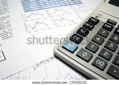 Calculator and financial data with graphs. Business concept. - stock photo