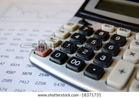 Calculator and financial information - stock photo