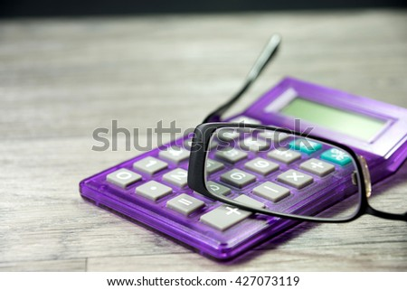 Calculator and glasses